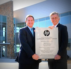 OOPS: Governor Beebe and HP exec in front of the Conway facility.